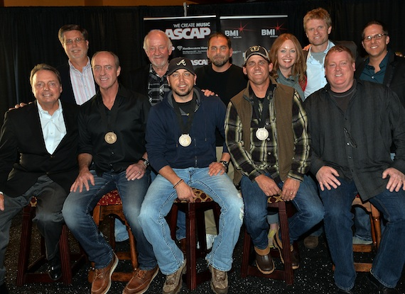 """BMI, ASCAP, Broken Bow Records and Music Row gathered at Nashville's The Pub in the Gulch to toast the team behind Jason Aldean's No. 1 song """"Night Train."""" The song was co-written by Michael Dulaney and Neil Thrasher. Pictured (back row, l-r): peermusic's Kevin Lamb, Broken Bow Records' Benny Brown, producer Michael Knox, Warner-Tamerlane's Alicia Pruitt, BMG Chrysalis' Kos Weaver, and Broken Bow Records' Jon Loba; (front row, l-r): BMI's Jody Williams, co-writer Michael Dulaney, Jason Aldean, co-writer Neil Thrasher, and ASCAP's Mike Sistad. Photo credit: Rick Diamond"""