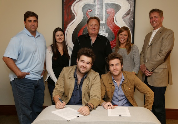 Pictured (seated, L-R): Zach Swon, Colton Swon. Pictured (standing, L-R): Sony Music Nashville's A&R VP Jim Catino, A&R Director Taylor Lindsey, and Chairman & CEO Gary Overton; Arista Nashville Promotion VP Lesly Tyson; and Hill Entertainment Group's Greg Hill. Photo Credit: Alan Poizner
