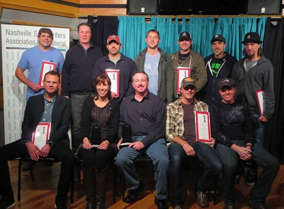 Front Row (seated L-R): Troy Verges, Maggie Cavender Award recipient Erika Wollam Nichols, Stephen Foster Award recipient Mark Ford, Kelley Lovelace, NSAI President Lee Thomas Miller. Second Row (standing L-R): Rhett Akins, NSAI Executive Director Bart Herbison, Dan Couch, Ashley Gorley, Ben Hayslip, Brett Warren, Brad Warren