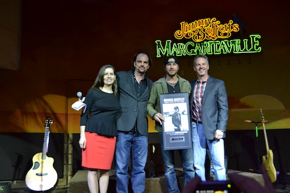 Dierks Bentley receives the MusicRow CountryBreakout Male Artist of the Year Award on Tuesday, Feb. 26, 2013. Pictured (L-R) Sarah Skates (MusicRow Senior News Editor), Sherod Robertson (MusicRow Publisher/Owner), Dierks Bentley, Steve Hodges (UMG Nashville, Sr. VP Promotions).