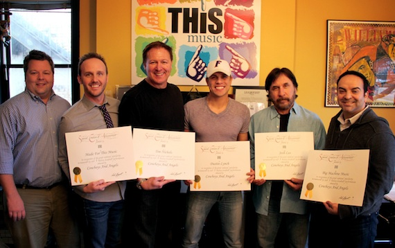 Pictured (L-R): BMI's Bradley Collins, This Music's Rusty Gaston, co-writer Tim Nichols, Dustin Lynch, co-writer Josh Leo, and Big Machine Music's Mike Molinar. Photo credit: Drew Maynard
