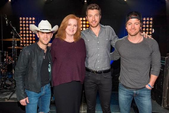 Pictured (L-R): Justin Moore; Suzanne Gordon, vice president of programming, Great American Country; Brett Eldredge, and Kip Moore. (Credit: Ed Rode)
