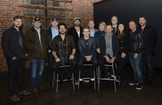 Back row (L-R): Jimmy Robbins; Rhett Akins; Ben Hayslip; Dallas Davidson; Tomlinson; CMA Chief Executive Officer Sarah Trahern; Luke Laird; Natalie Hemby; Shane McAnally, who is also a member of the CMA Board; CMA Board member Rob Beckham. Front row (L-R): Chris DeStefano; Hunter Hayes; Troy Verges.