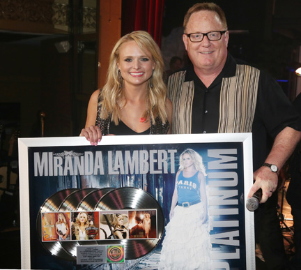 At the Sony Music Nashville Boat Show, Chairman & CEO Gary Overton surprised Miranda Lambert with a plaque commemorating the Platinum certification of each of her first four albums. (L-R): Lambert, Overton. Photo:  Alan Poizner