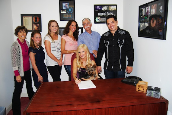 Standing (L-R): Martha Moore (so much MOORE media), Kelsey Edgar (SSM), Sam Holly (SSM), Janine LeClair (SSM Office Manager), Ben Ewing (SSM General Manager) and Dean Scallan (Producer).Seated: Kayla Adams and her Yorkshire Terrier Tory  (Photo Courtesy of SSM Nashville Records)