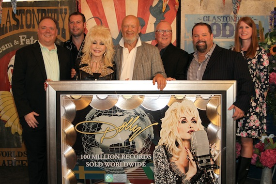 Pictured (L-R): Webster Public Relations' Kirt Webster, Guesty PR's Steve Guest, Dolly Parton, Glastonbury Owner Michael Eavis, CTK Management CEO Danny Nozell, and Sony Music's Faye Donaldson.
