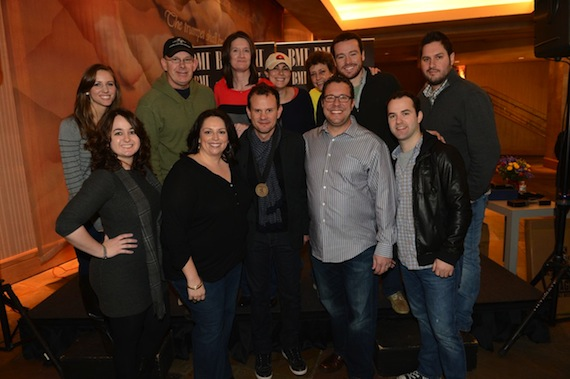 Verges and his UMPG team in 2013: Top row (L-R): Amanda Merki, Executive Assistant to Kent Earls, UMPG Nashville; Ron Stuve, VP of A&R/Special Projects, UMPG Nashville; Whitney Williams, Creative Director, UMPG Nashville; Missy Wilson, Senior Creative Director, UMPG; Tammy Helm, Manager of Administration, UMPG Nashville; Travis Gordon, Creative Manager, UMPG Nashville; Freeman Wizer, Creative Director, UMPG Nashville