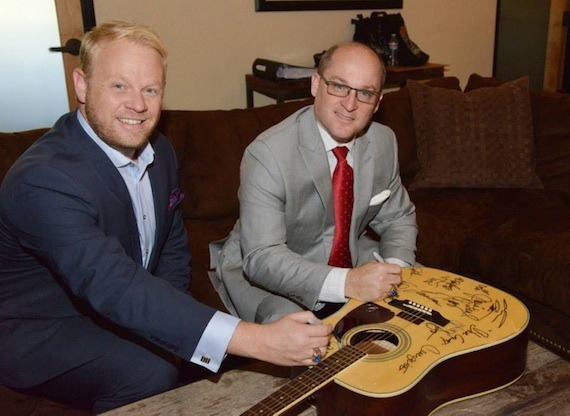 Pictured: Dailey & Vincent sign a guitar at the Academy of Country Music in Encino, Calif. Photo: Michel Bourquard/ACM