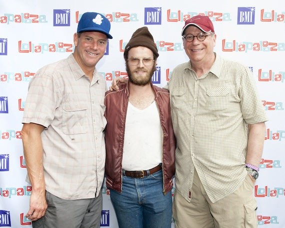 BMI Executive Director, Writer-Publisher Relations Mark Mason (left) and BMI Vice President, Writer-Publisher Relations Charlie Feldman (right) flank Fly Golden Eagle's Ben Trimble backstage at Lollapalooza.