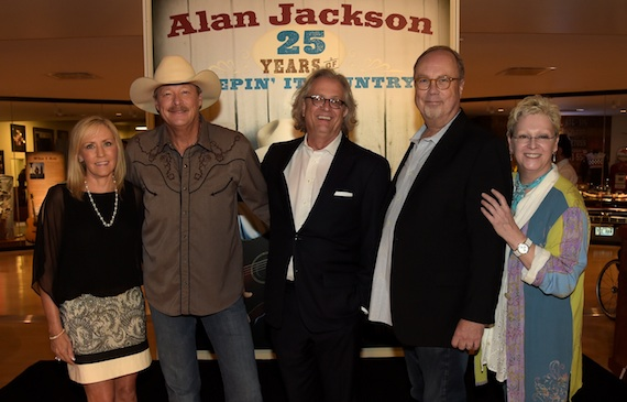 """Pictured are: (L-R): Denise Jackson, Alan Jackson, the Country Music Hall of Fame and Museum's Kyle Young, Universal Music Nashville's Mike Dungan, and the Country Music Hall of Fame and Museum's Carolyn Tate at the opening of the """"Alan Jackson: 25 Years of Keepin' It Country"""" exhibit at Country Music Hall of Fame and Museum on August 27, 2014 in Nashville, Tennessee.  (Photo by Rick Diamond/Getty Images for Country Music Hall Of Fame And Museum)"""