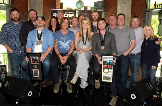 Pictured, Seated: Jon Nite, Keith Urban, Nicolle Galyon, Jimmy Robbins. Standing: UMG's Royce Risser,  Sony/ATV Tree's Josh VanValkenburg,  ASCAP's LeAnn Phelan, Producer Nathan Chapman, BMI's Jody Williams, UMG's Joe Fisher, Warner/Chappell's BJ HIll, ASCAP's Mike                  Sistad, Universal Publishing's Kent Earls, BMI's Bradley Collins and UMG's Cindy Mabe. Photo: Rick Diamond
