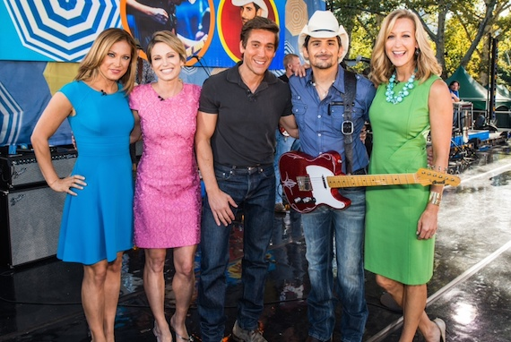 Pictured (L-R):  GMA's Ginger Zee, Amy Robach, and David Muir; Paisley; and GMA's Lara Spencer.
