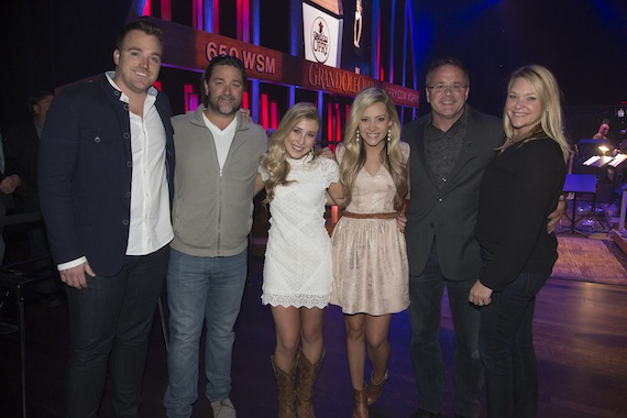 Pictured (L-R): Dot Records National Director Promo/Marketing Kris Lamb, Dot Records GM Chris Stacey, Maddie, Tae, Grand Ole Opry Vice President/General Manager Pete Fisher and 377/Red Light Management manager Haley McLemore. Photo: Chris Hollo, Courtesy Grand Ole Opry© 2014