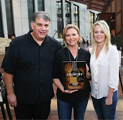 Photo: ACM CEO Bob Romeo (left) and ACM EVP/Managing Director Tiffany Moon (right) pose with ACM SVP and This is Country: A Backstage Pass to the Academy of Country Music Awards author Lisa Lee (center) at the Country Music Hall of Fame and Museum in Nashville, TN.  (Photo Credit: Terry Wyatt / Courtesy of Academy of Country Music)