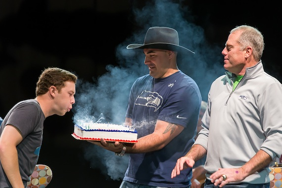 Scotty McCreery blows out the candle on his birthday cake. Photo: David Conger