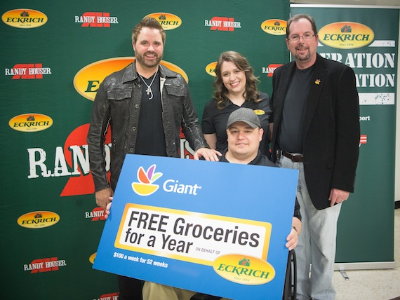 Air Force Staff Sergeant Christopher Solso and his wife, Clare, are presented free groceries for a year and a VIP trip to Tucson, Arizona on behalf of Eckrich.