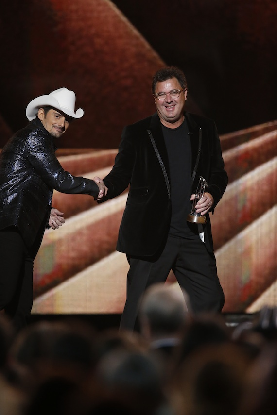 """Brad Paisley presents Vince Gill with the Irving Waugh Award of Excellence during """"The 48th Annual CMA Awards."""" Photo: John Russell / CMA"""