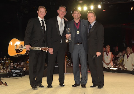 Rhett Akins (second from right) accepts the award for Songwriter of the Year with BMI Assistant Vice President, Writer/Publisher Relations, Clay Bradley, BMI President and CEO Mike O'Neill, and BMI Vice President, Writer/Publisher Relations, Jody Williams onstage at the BMI 2014 Country Awards at BMI on November 4, 2014 in Nashville, Tennessee. Photo:  Rick Diamond/Getty Images for BMI