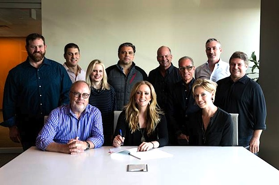 Front Row (L-R): UMG Nashville Chairman & CEO Mike Dungan, Clare Dunn, UMG Nashville A&R Sr. Director Stephanie Wright. Back Row (L-R): UMG Nashville SVP Promotion Royce Risser, UMG Nashville Vice President Business and Legal Affairs Rob Femia, UMG Nashville President Cindy Mabe, Red Light Management's Shawn McSpadden, WME's Kevin Neal, Greenberg Traurig LLP's Jess Rosen, UMG Nashville Senior Vice President A&R Brian Wright, UMG Nashville Senior Vice President/COO Tom Becci. Photo: Mary Caroline Russell