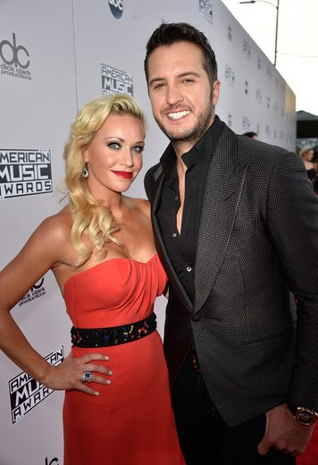 Caroline and Luke Bryan on the AMA red carpet. Photo: AMA