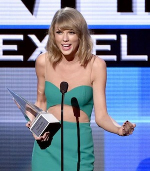 Taylor Swift accepts at the AMA Awards.