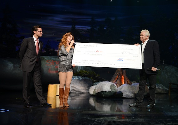General Manager of Caesars Palace Sean McBurney (L) and President of Global Touring with AEG Live John Meglen (R) present a check to Shania Twain  for her Shania Kids Can Foundation during her final performance of Shania: Still The One at The Colosseum at Caesars Palace. (Photo: Denise Truscello/WireImage)