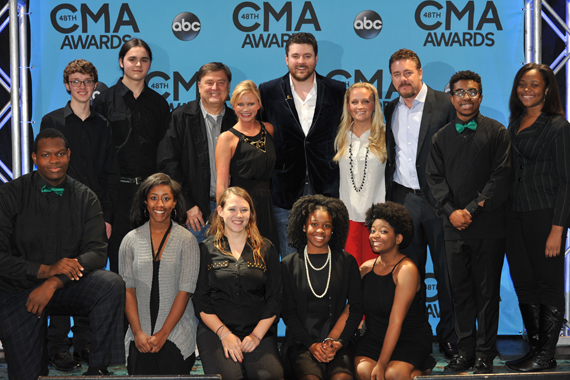 Students from the Hillsboro High School choral group after performing at the CMA Awards radio remotes Nov. 2 in Nashville. Pictured (L-R): (back row, third from left) CMA Foundation Board member Lon Helton; CMA Senior Director of Membership and Balloting Brandi Simms; CMA Board member Chris Young; CMA Community Outreach Manager Tiffany Kerns; and CMA Board member Rob Beckham. Photo: Scott Hunter.