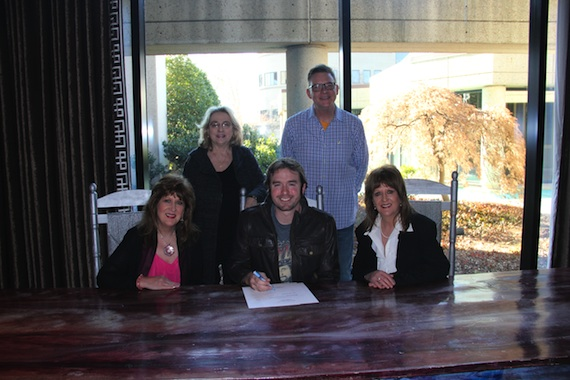 Pictured (L-R): Seated: Debbie Moore, James Carothers, Carrie Moore-Reed. Standing: JoAnn Berry (Manager) and Perry Howard (BMI Director,Writer/Publisher Relations)