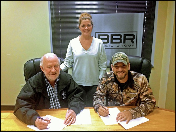Pictured (L-R): BBR Music Group Owner/CEO Benny Brown; Magic Mustang Music VP Juli Newton-Griffith; artist Craig Campbell.