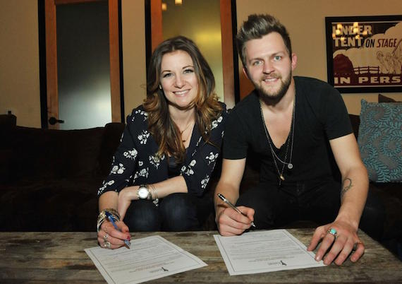 Native Run sign up as members of the ACM. Photo: Michel Bourquard/Courtesy of the Academy of Country Music