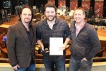 Chris Young Presented With 'MusicRow' Challenge Coin For No. 1 Song