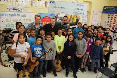 Rascal Flatts (back row, L-R): Joe Don Rooney, Gary LeVox, and Jay DeMarcus visit with students at Miramonte Elementary School. Photo: Courtesy The GreenRoom PR
