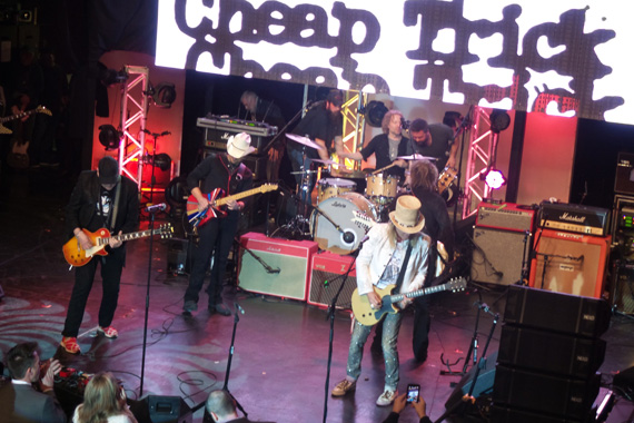 Brad Paisley performs with the night's show-closing special surprise guest, Cheap Trick.