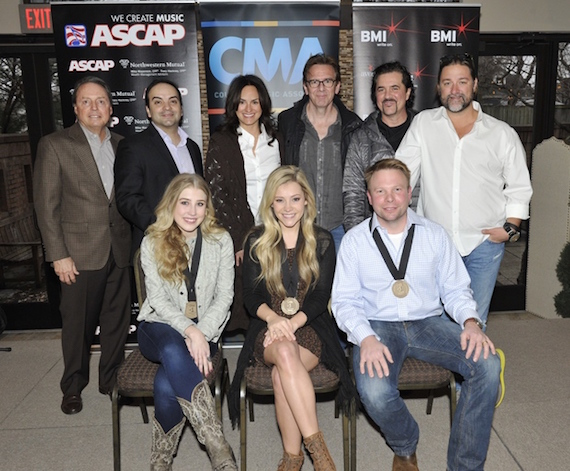 Pictured (L-R): (front row) Maddie & Tae with co-writer Aaron Scherz, (back row) BMI's Jody Williams, Big Machine Music's VP Publishing Mike Molinar, ASCAP's LeAnn Phelan, producer Dann Huff, Big Machine Label Group President & CEO Scott Borchetta and Dot Records General Manager Chris Stacey. Photos by Frederick Breedon.