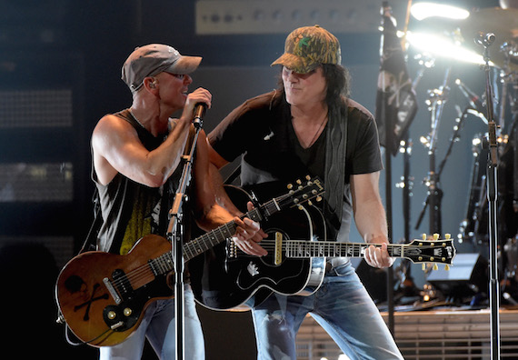 Joe Walsh joins Kenny Chesney for several songs in Nashville. Photo: Rick Diamond/Getty Images