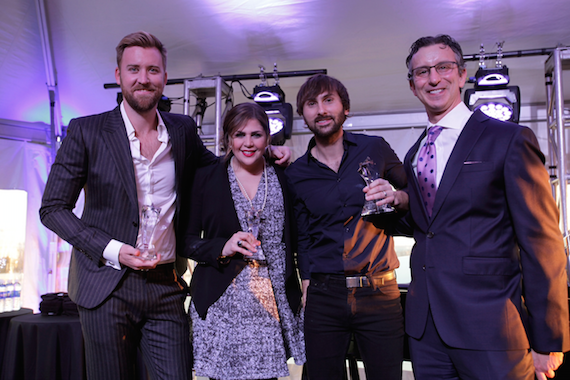 Pictured (L-R): Lady A's Charles Kelly, Hillary Scott, Dave Haywood and NMPA CEO David Israelite.