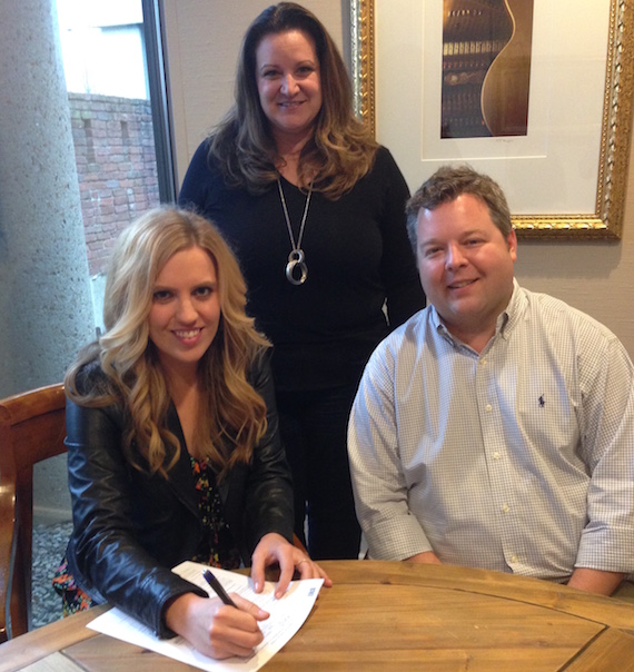Pictured (seated, L-R): SaraBeth, and BMI's Senior Director, Writer-Publisher Relations Bradley Collins. Standing: Verge Management's Nancy Eckert
