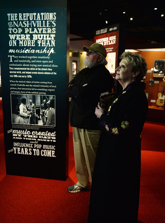 Nashville Cat Charlie Daniels (background) browses the galleries with CMHoF's Carolyn Tate (foreground). Photo: Jason Davis, Getty Images