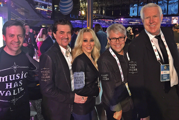 "Pictured (L-R): Big Machine Label Group executives sport the ""Music Has Value"" logo at the ACM Awards on Sunday night. L-R, Big Machine's Matthew Hargis, Scott Borchetta, Sandi Spika Borchetta, Jimmy Harnen and George Briner."