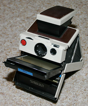 SX-70 Model 2 with film cartridge protruding from the front. Photo: Wikipedia