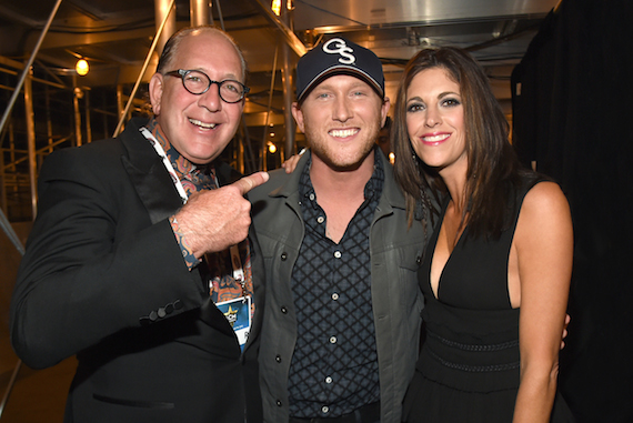 Pictured (L-R): John Esposito, Cole Swindell, Kerri Edwards. Photo: Rick Diamond/ACM2015/Getty Images for DCP