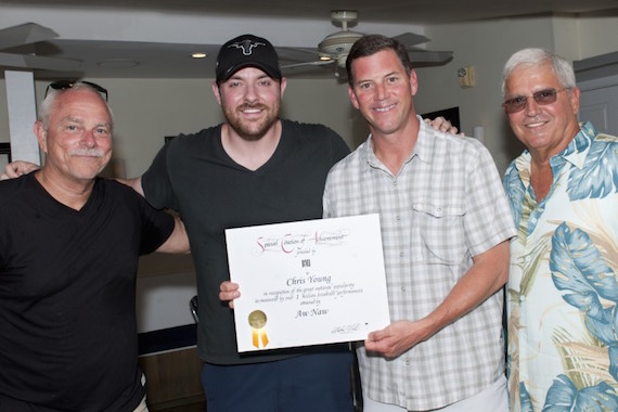 Pictured: KWSWF's Charlie Bauer, Chris Young, BMI's Mark Mason and Mayor Craig Cates gather for a photo after presenting Young with a certificate of achievement during Key West Songwriter's Festival on May 9, 2015, in Key West, Fla. Photo: Erika Goldring.