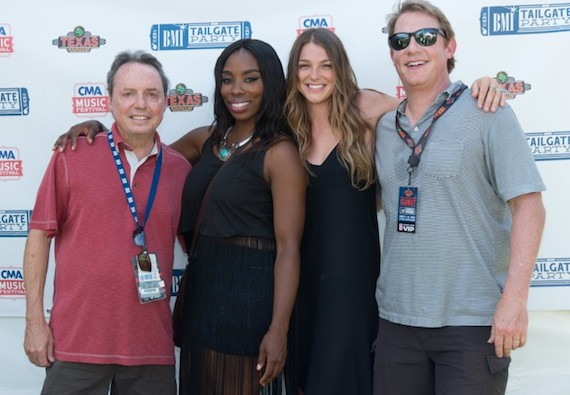BMI's Jody Williams and Clay Bradley pose with BMI singer/songwriters Kallie North and Jessy Wilson of Muddy Magnolias backstage at the BMI Tailgate party.