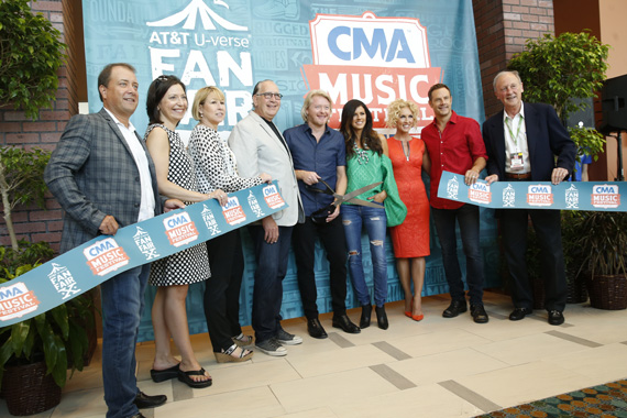Thursday's Artist of the Day Little Big Town cut the ribbon to AT&T U-verse® Fan Fair X at the Music City Center, kicking off the 2015 CMA Music Festival. (L-R): Brian Collins, Vice President of Wireline Consumer Marketing, AT&T Home Solutions; Sally Williams, Vice President, Business and Partnership Development of Ryman Auditorium and CMA Board President Elect; Sarah Trahern, CMA Chief Executive Officer; John Esposito, CEO Warner Music Nashville and CMA Board President; Little Big Town's Phillip Sweet, Karen Fairchild, Kimberly Schlapman, and Jimi Westbrook; and Frank Bumstead, Chairman Flood, Bumstead, McCready & McCarthy and CMA Board Chairman. Photo: John Russell/CMA