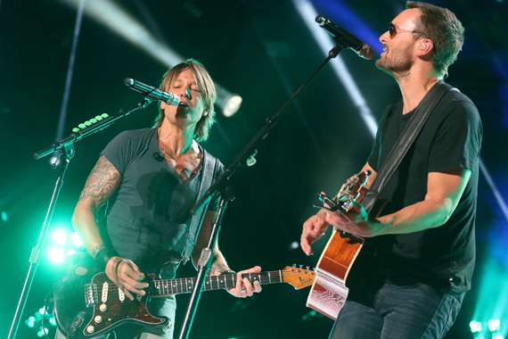 """Eric Church joined Keith Urban for a performance of their No. 1 song """"Raise 'Em Up"""" during Sunday night's concert at LP Field during the 2015 CMA Music Festival. Photo : John Russell/CMA"""