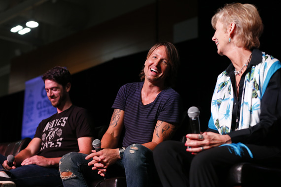 """Notes for Notes CEO Phil Gilley, Keith Urban, and Metro Music Specialist at John F. Kennedy Middle School Linda Friend participate in a music education panel during Urban's special appearance on the CMA Close Up stage at AT&T U-verse Fan Fair X during CMA Music Festival Thursday (June 11) in Nashville where he was named the first national ambassador for the CMA Foundation's """"Music Education Matters"""" campaign. Photo: Donn Jones/CMA"""