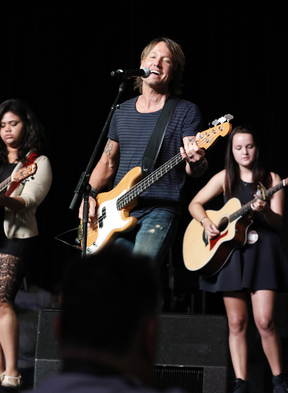 Keith Urban performs with Nashville School of the Arts students Kelly Holmes (left) and Emily Davis (right) during a special appearance on the CMA Close Up stage at AT&T U-verse Fan Fair X during CMA Music Festival Thursday in Nashville. Photo: Donn Jones/CMA