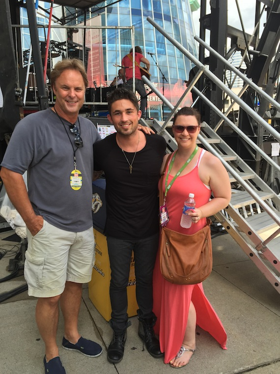 "Atlantic Records artist Michael Ray brought his Top 15 and climbing debut single, ""Kiss You In The Morning,"" to sunbathed crowd at the CMA Music Festival. Following his performance yesterday on the Bud Light Stage at Bridgestone Arena, Ray visited with fans, friends and family. Photo from left to right – Scott Hendricks, Ray's producer and EVP A&R Warner Music Nashville; Ray and Rebekah Gordon, Director A&R, WMN"