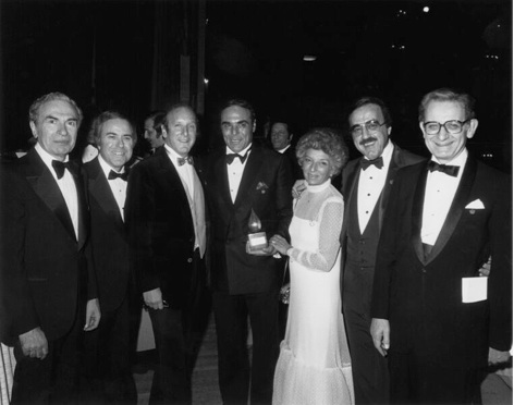 Pictured (L-R): Dave Rothfeld, Floyd Glinert, Clive Davis, Dick Asher, Sheila Asher, Tony Martell and Dr. Jim Holland. Photo Credit: Getty Images)