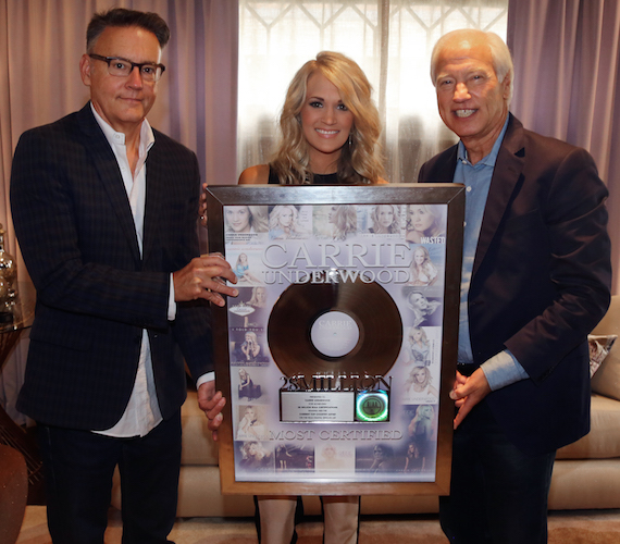 Pictured (L-R):  Sony Music Nashville Chairman & CEO Randy Goodman, Underwood, and Recording Industry Association of America (RIAA) Chairman & CEO Cary Sherman   (Photo by Alan Poizner)